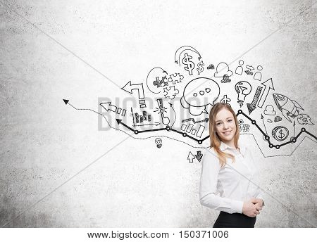 Smiling girl with black hair standing near concrete wall with blue graph and icons. Concept of consulting. Mock up