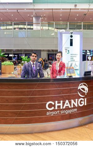 SINGAPORE - SEPTEMBER 12, 2016: portrait of a airport staff at information desk in Singapore Changi Airport. Changi Airport, is the primary civilian airport for Singapore.
