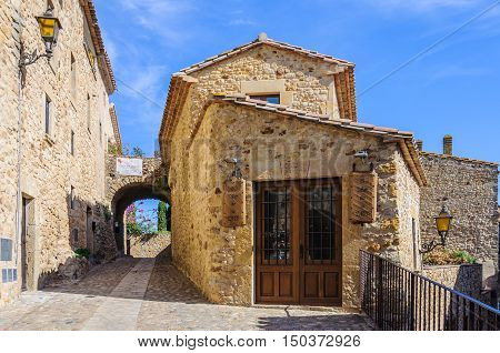PALS, SPAIN - SEPTEMBER 26, 2015: Medieval streets in the village of Pals in Catalonia Spain