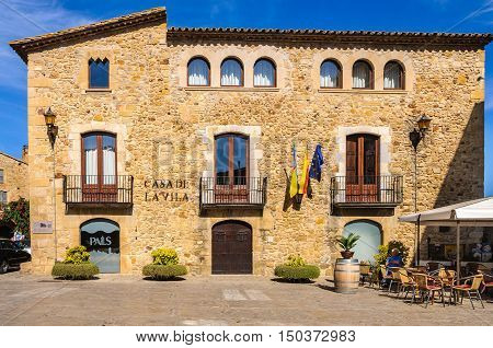 PALS, SPAIN - SEPTEMBER 26, 2015: The main square and the town hall in the village of Pals in Catalonia Spain
