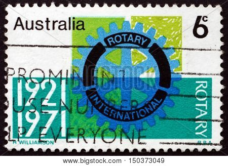 AUSTRALIA - CIRCA 1971: a stamp printed in Australia shows Rotary Emblem First International Rotary Convention Held in Australia Sydney circa 1971
