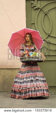 Lvov Ukraine- August 22 2016:girl in a historic clothes is selling sweets