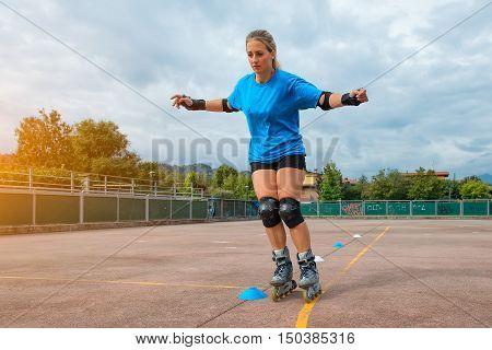 Blonde Sports Girl Does Slalom Rollerblading