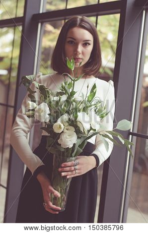 Dark-haired Girl With A Bunch Of White Flowers