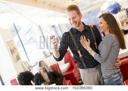 Young couple taking selfie in the diner