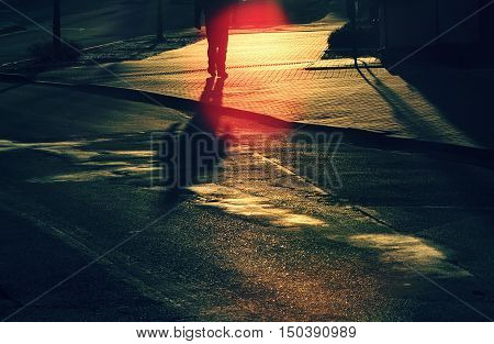 Shadow of a man on the road