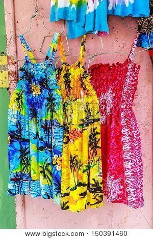 Tropical dresses in a Caribbean market.