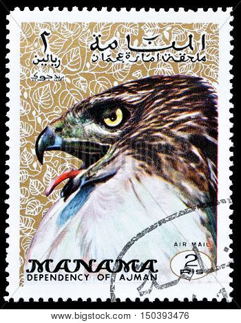 MANAMA - CIRCA 1970 : Cancelled postage stamp printed by Manama, that shows Red Tailed Hawk.