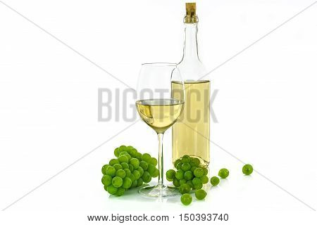 Bottle of white wine and a wineglass next to grapes isolated on white background