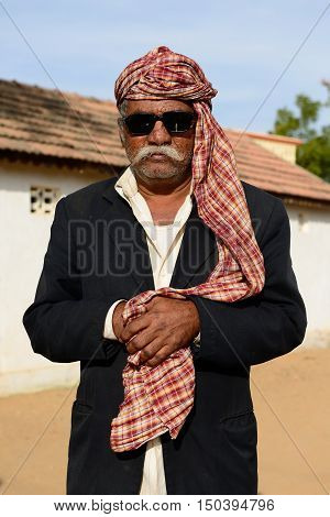 BHUJ RAN OF KUCH INDIA - JANUARY 13: The tribal men in the traditional dress he is going through deserts in of Ran of Kuch in the Gujarat state in India Ran of Kuch in January 13 2015