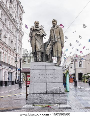 Moscow Russia -September 082016: Monument to the Stanislavsky and Nemirovich-Danchenko in Kamergersky Lane. By the lane walking pedestrians