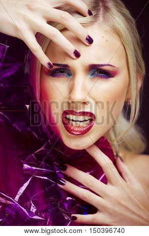 beauty woman with creative make up, many fingers on face close up agressive halloween look