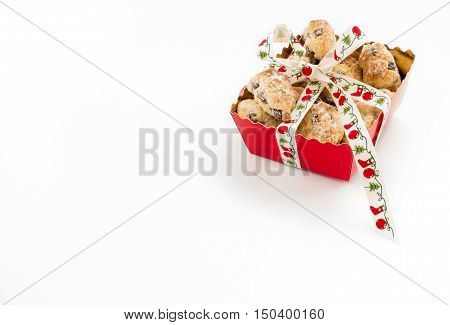 Mini Christstollen in a festive red tray decorated with ribbon isolated on white background. Lots of copy space.