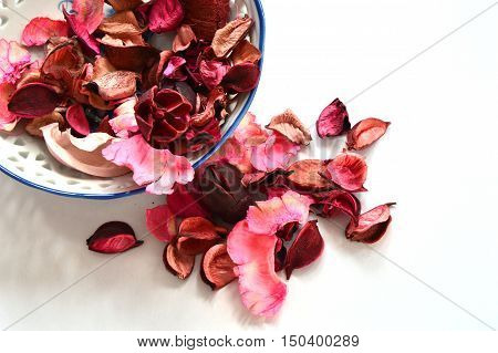 dried colorful Potpourri pot with white background