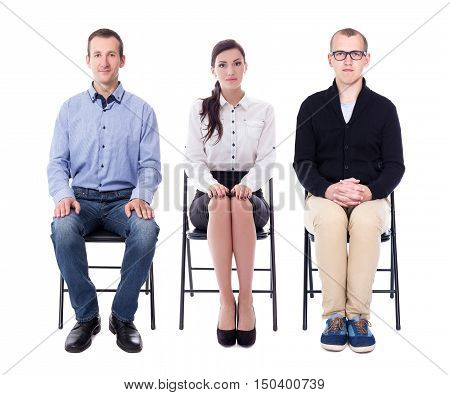 interview concept - young people sitting on office chairs isolated on white background