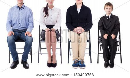 career concept - young business people and one little boy sitting on office chairs isolated on white background
