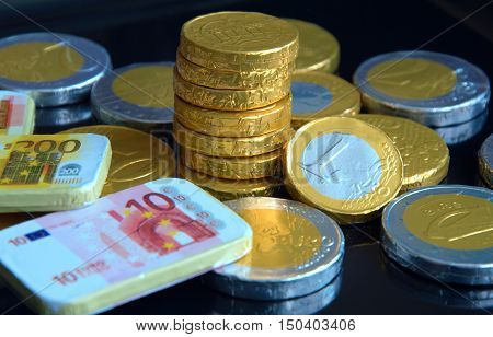 chocolate coins with black background for good luck ,rich and wealthy