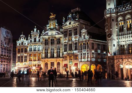 Illuminated houses at the Grand Place square at night in Brussels Belgium