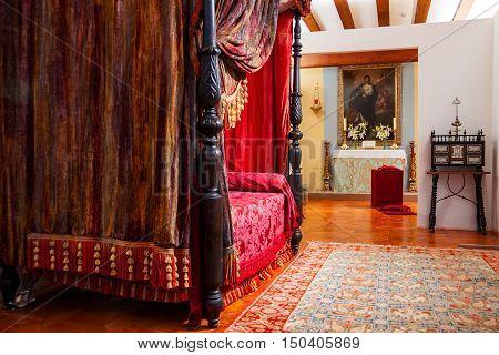 MANZANARES EL REAL SPAIN - JULY 12 2012: Interiors of Mendoza Castle. Bedroom with medieval decoration.