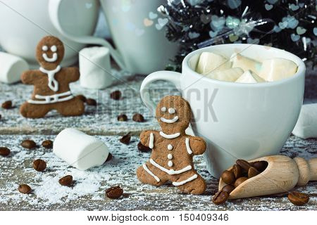 Winter breakfast: coffee with marshmallow gingerbread beautiful background