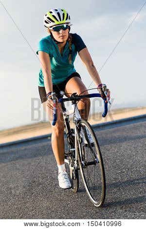 Beautiful Young Woman Cycling On The Road.