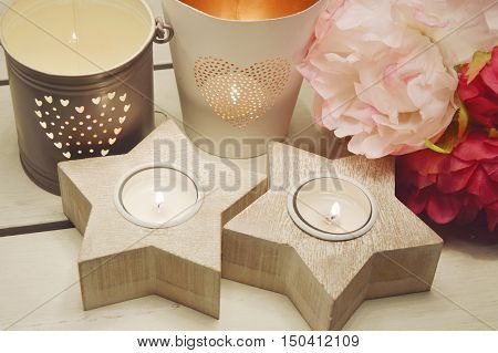 wooden star candle holder with plastic flower