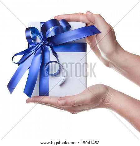 Hands holding gift in package with blue ribbon isolated on white