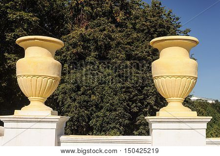 Two old big yellow flowerpots on Independence Avenue in Minsk Belarus. Stalin's empire.