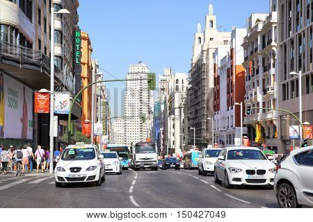 MADRID, SPAIN - September 06, 2016: Road traffic on Gran Via near the Capitol building in Madrid