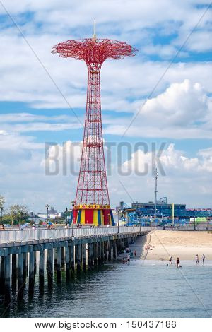 NEW YORK,USA - AUGUST 18,2016 : The Coney Island Pier and the Parachute Jump tower on a summer day