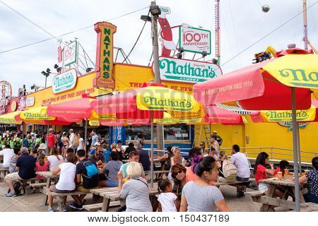 NEW YORK,USA - AUGUST 18,2016 : Customers at the original Nathan's Famous hot dogs stand in Coney Island