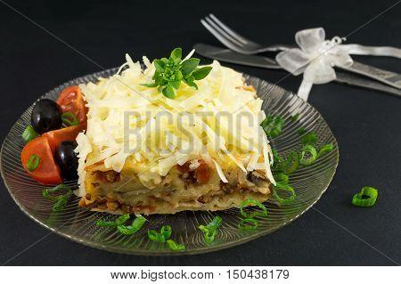 Lasagna Portion Served With Fresh Vegetables