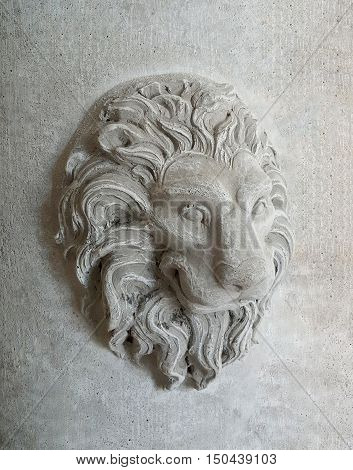 Lion head statue, Gray concrete wall texture background