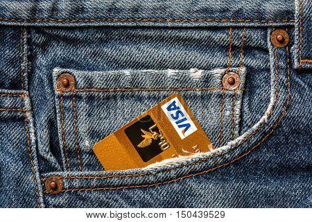Tallinn, Estonia, September 28.2016. Plastic card VISA gold  in jeans pocket