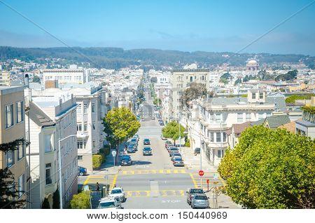 SAN FRANCISCO CALIFORNIA - 2015 JUNE 24: road with green trees and buildings at San Francisco USA