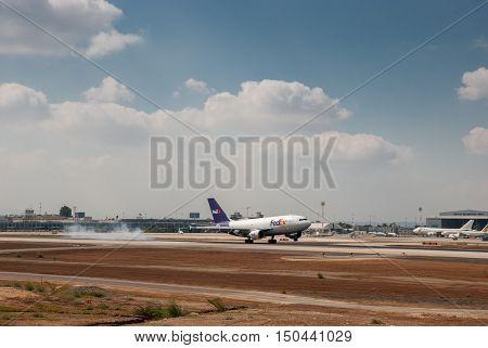 BEN-GURION AIRPORT ISRAEL - JULY 21 2010: The Fedex airplane landing in Ben-Gurion Airport. Israel