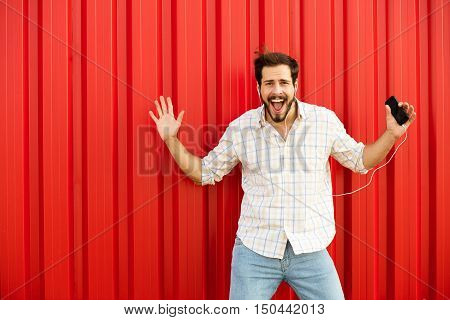 Excited Man Smiling To Camera On Red Background