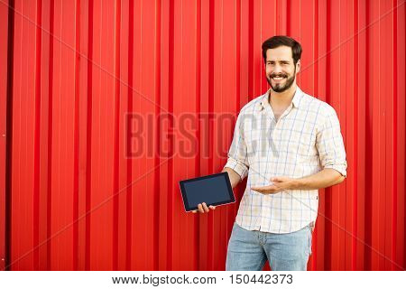 Smiling Man With Tablet On Background