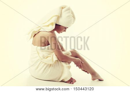 Alternative medicine and body treatment concept. Atractive young woman after shower with towel. Instagram style