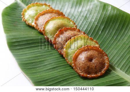 Malaysian traditional cake, Kuih Pinjaram or Penyaram on banana leaf