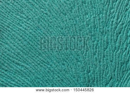 turquoise background from a soft wool textile material closeup. Fabric with natural texture. Cloth backdrop.