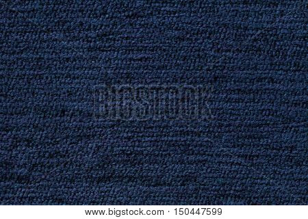 Navy blue background from a soft textile material. sheathing fabric with natural texture. Cloth backdrop.