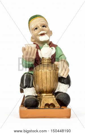 Figurine hospitable elderly man at the samovar.