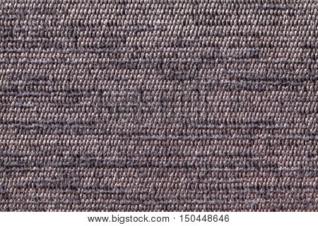 Gray background of a knitted textile material with pattern. Fabric with a striped texture closeup.