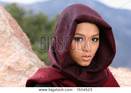 Young muslim woman in a mountains wearing hijab poster