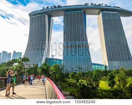 SINGAPORE, REPUBLIC OF SINGAPORE - JANUARY 09, 2014: The tourists take photo near Marina Bay Sands Hotel
