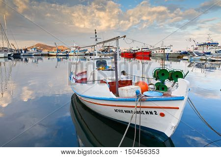 NAXOS, GREECE - SEPTEMBER 22, 2016: Boats in the port of Naxos early in the morning on September 22, 2016.