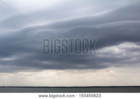 Asperatus-undulatus dark clouds in the stormy sky