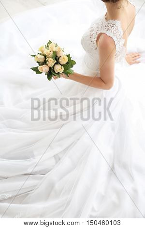Bride in beautiful dress with wedding bouquet