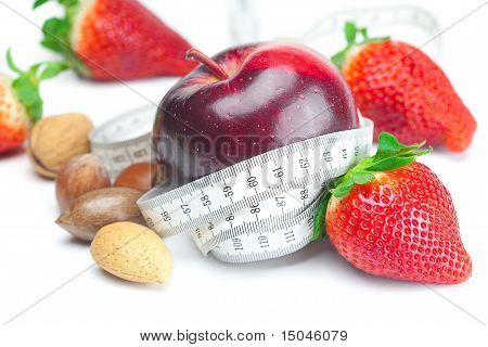 Apple,big Juicy Red Ripe Strawberries,nuts And Measure Tape Isolated On White